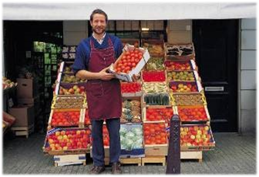 image of Farmer in front of produce stand
