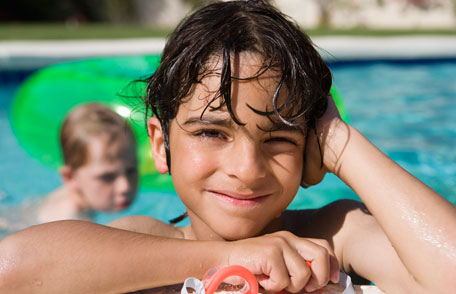 image of little boy at the swimming pool